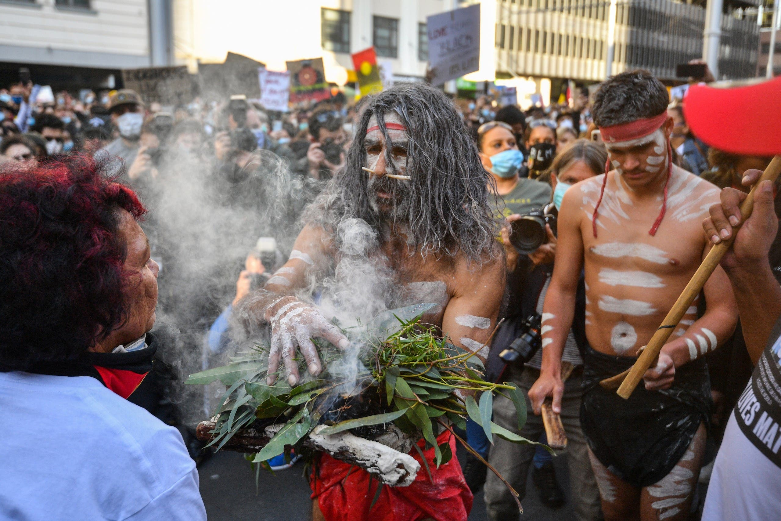 A man in aboriginal dress takes part in the Black Lives Matter protests in Sydney, June 6, 2020. (AFP)