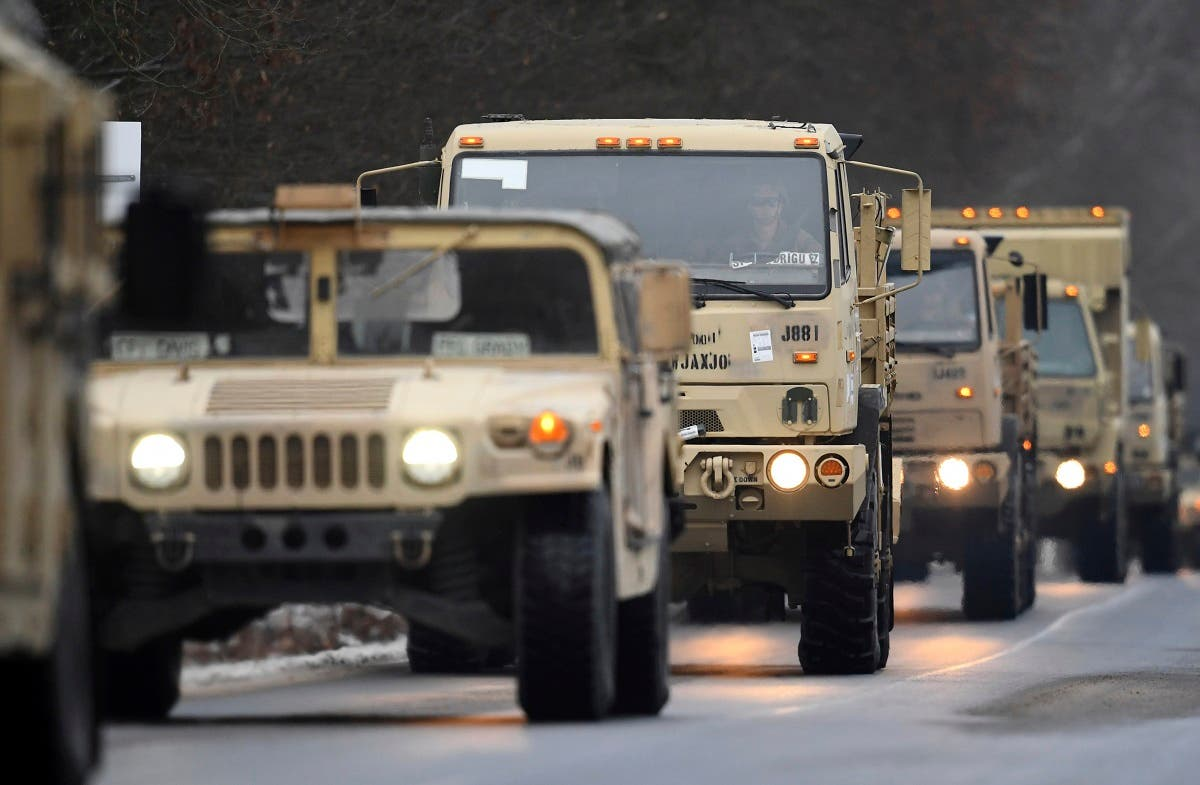 US military vehicles driving along a road at a military training area near Brueck, Germany, Wednesday, Jan. 11, 2017. (AP)