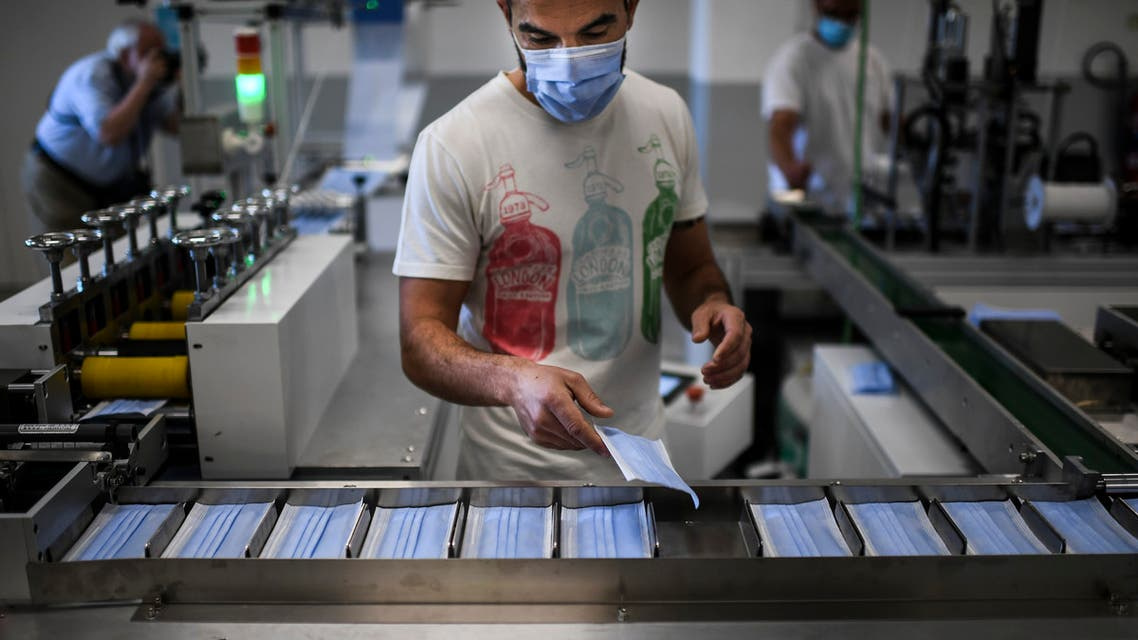 A worker selects masks during the production of disposable face masks at a mask factory in Cascais, in the outskirts of Lisbon on June 5, 2020. The municipality of Cascais produces its own face masks for its 200,000 inhabitants. The town, which has acquired two production units from China, has set up a factory which will have to produce about five million masks per month.