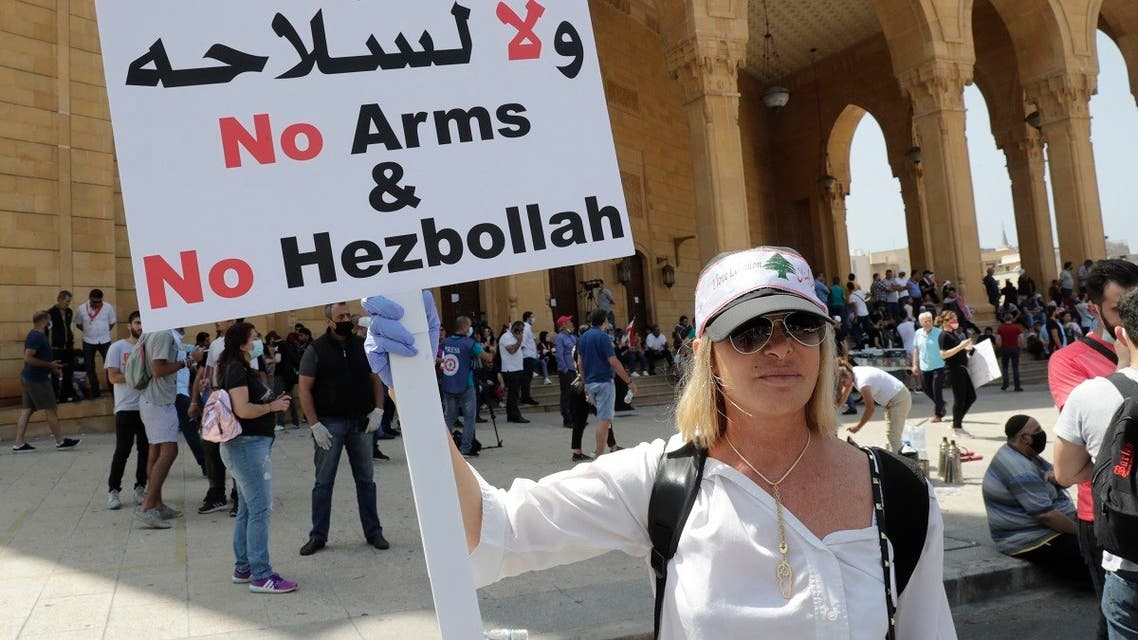 A Lebanese protester holds a placard in front of Mohammad al-Amin mosque during a demonstration in central Beirut, on June 6, 2020. (AFP)
