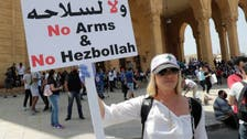Splinters in Lebanon protests emerge as some call for Hezbollah disarmament