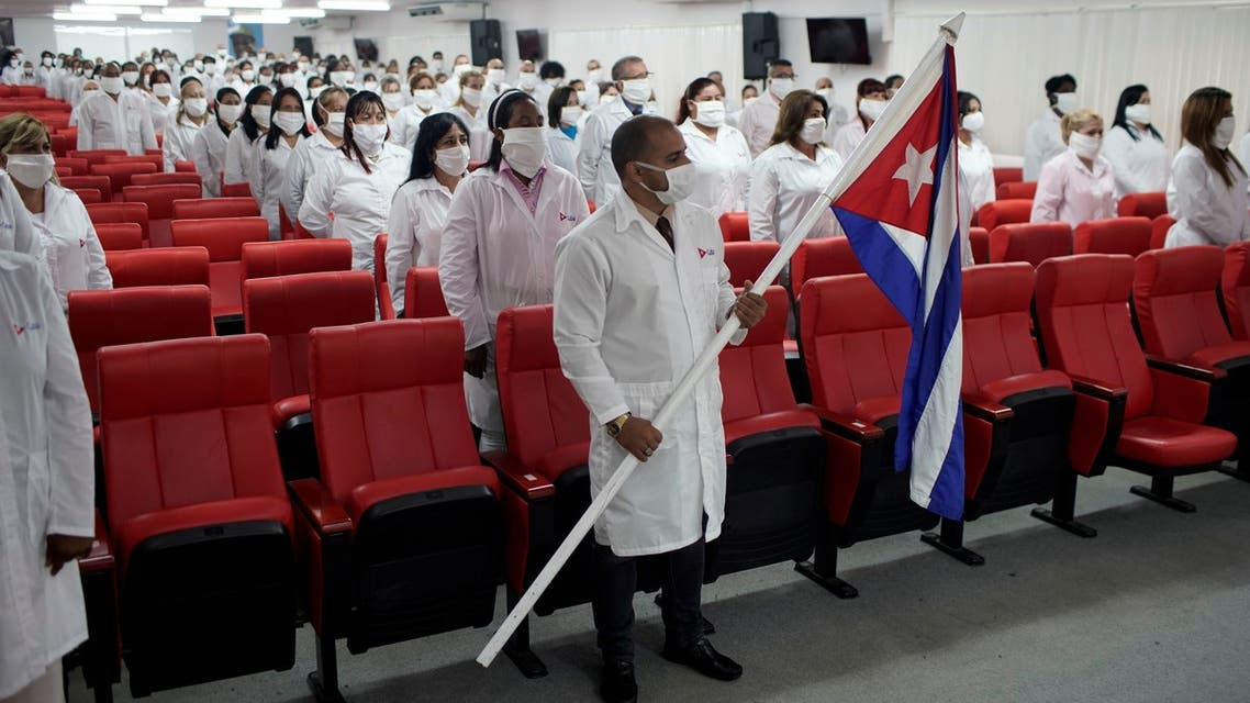 Cuban doctors sit prior to a farewell ceremony before departing to Kuwait to assist, amid the coronavirus disease (COVID-19) outbreak, in Havana, Cuba June 4, 2020. REUTERS/Alexandre Meneghini