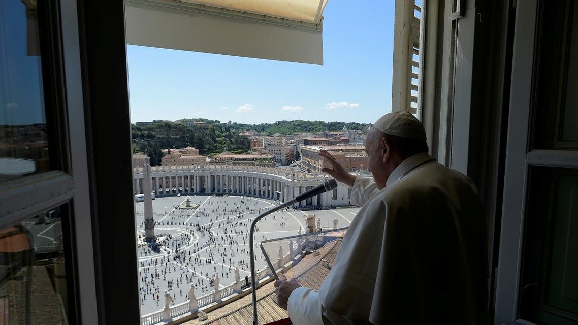 Pope Francis gestures as he leads the Regina Coeli prayer from his window in the newly reopened St. Peter's Square after months of closure. (Reuters)