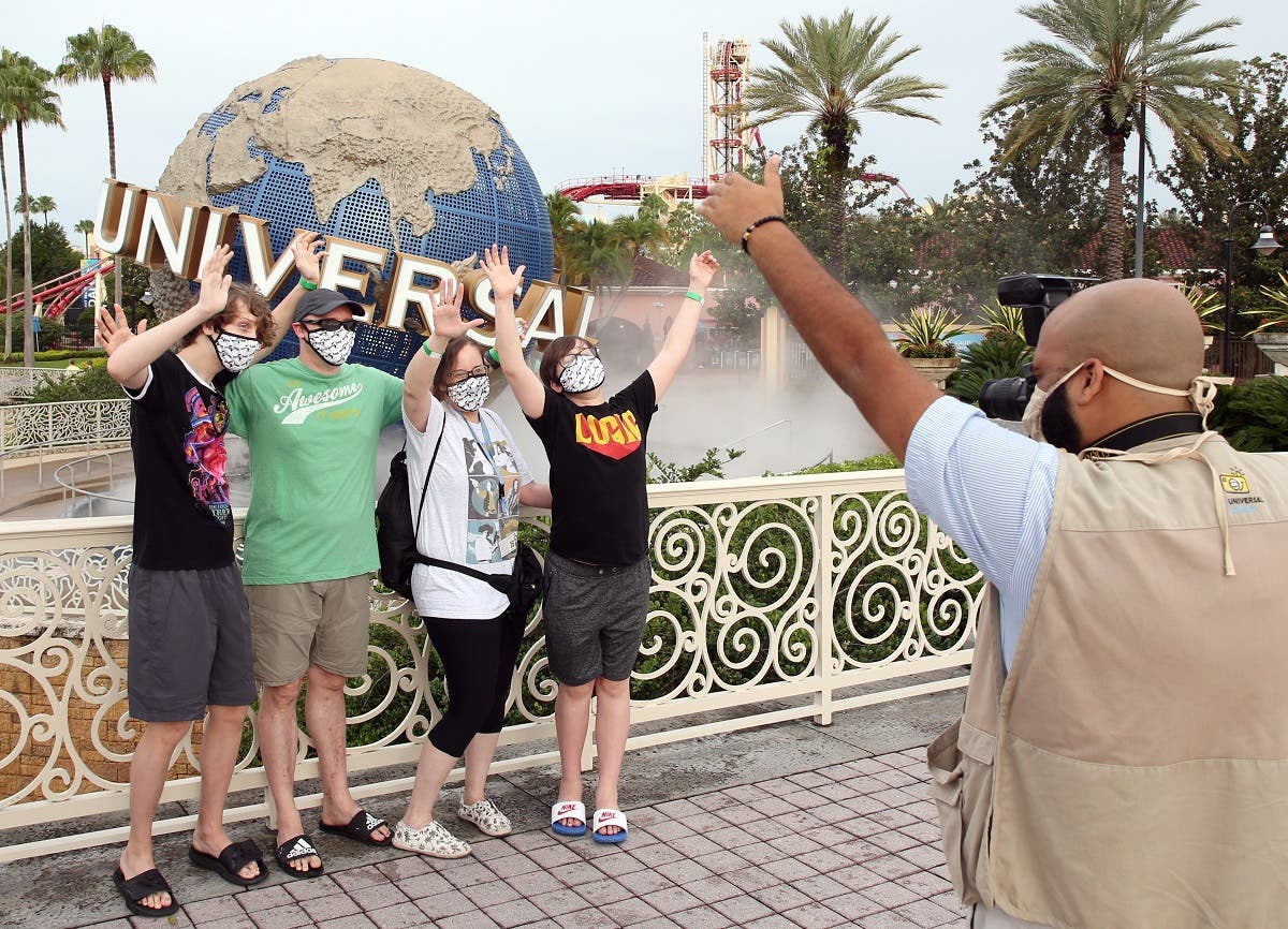 Visitors get a souvenir snapshot at Universal Studios theme park on the first day of reopening from the coronavirus pandemic, on June 5, 2020, in Orlando, Florida. (AFP)