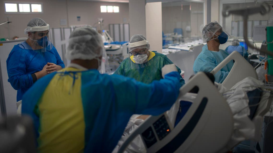 A nurse works at the Intensive Care Unit (ICU) ward where patients infected with the novel coronavirus, COVID-19, are being treated at the Doctor Ernesto Che Guevara Public Hospital in Marica city, state of Rio de Janeiro, Brazil, on June 5, 2020.