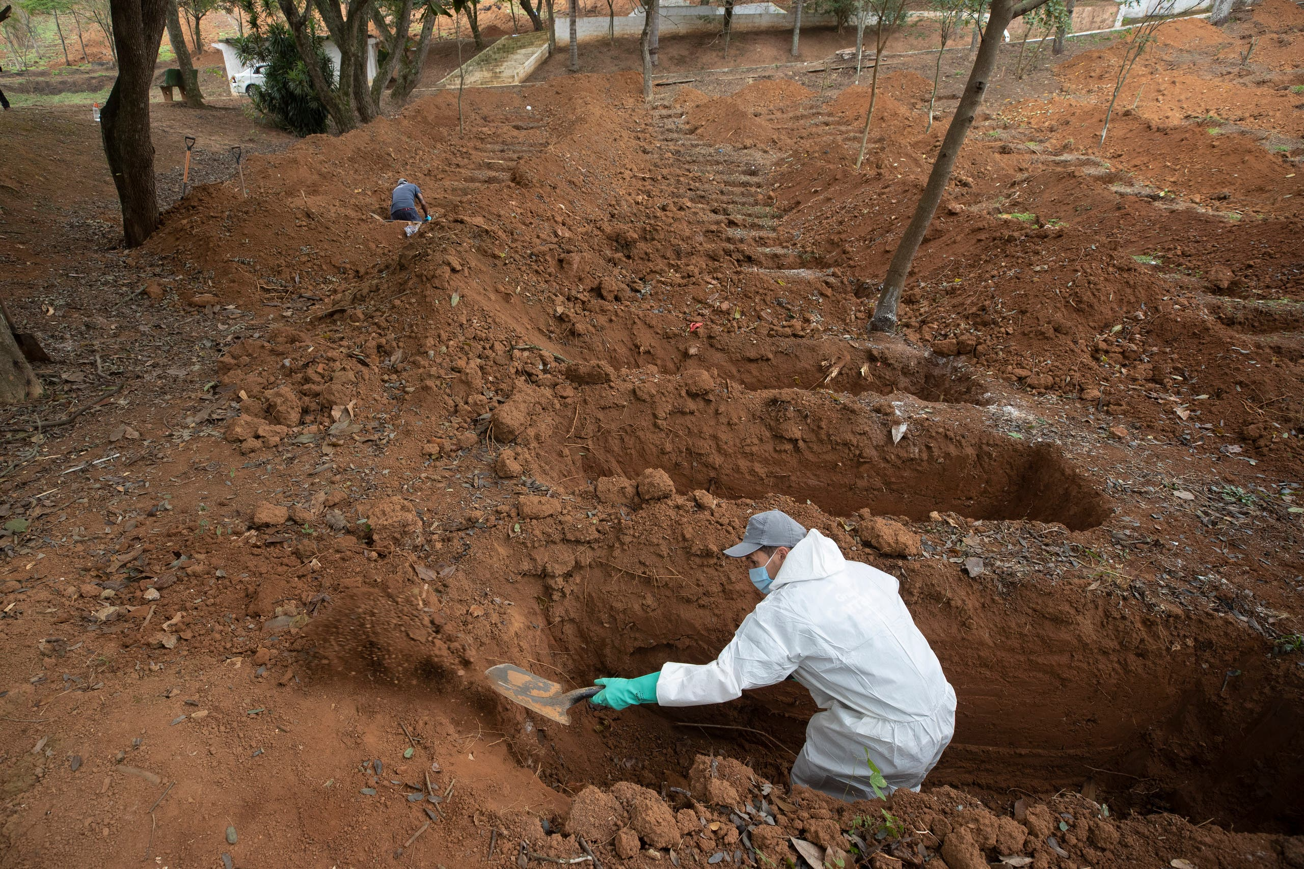 A cemetery worker digs graves in a section exclusively for COVID-19 victims at the Sao Luiz cemetery in Sao Paulo, Brazil, on June 4, 2020. (AP)