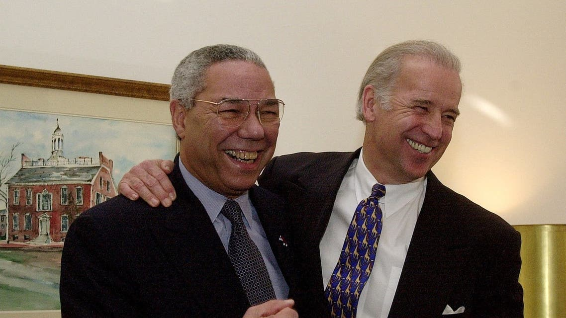 General Colin Powell, left, and then-Sen. Joe Biden pose for photographers on Capitol Hill on Jan. 9, 2001. (File photo: AP)