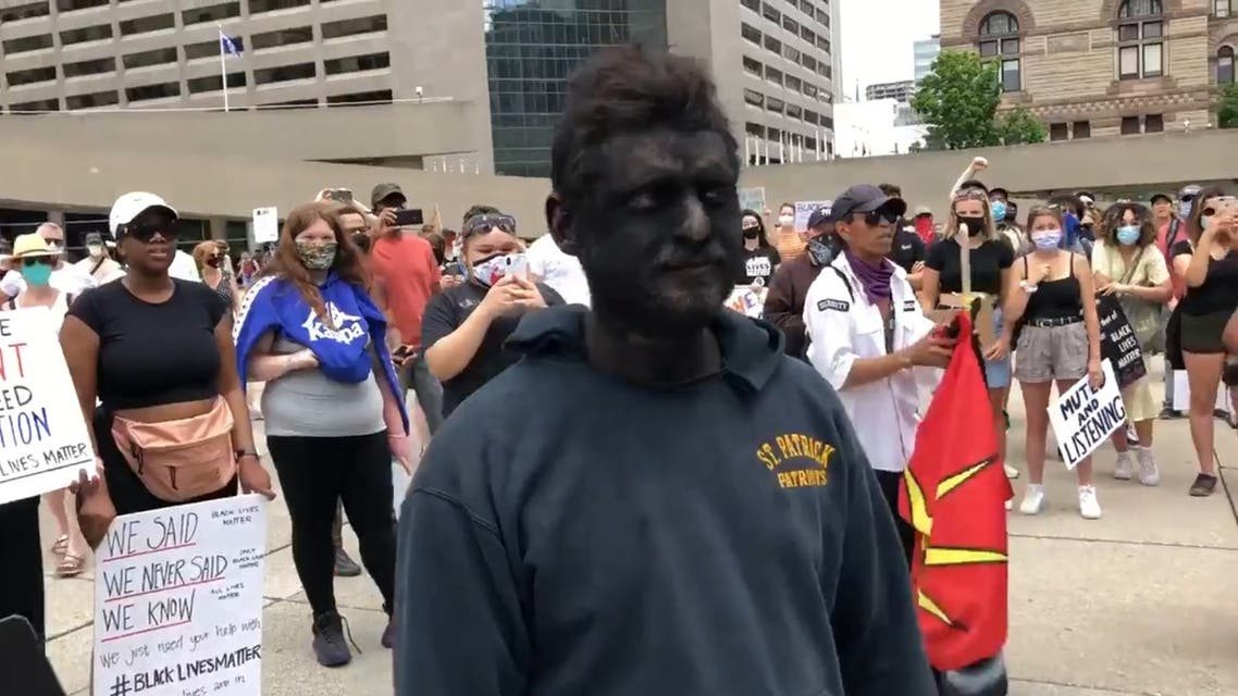 A man wears blackface at an anti-black racism rally in Toronto, Canada. (Twitter)