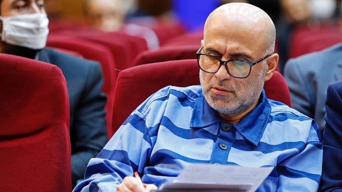 Akbar Tabari, the former deputy head of Iran's administrative affairs, takes notes during his trial in the capital Tehran on June 7, 2020. (AFP)
