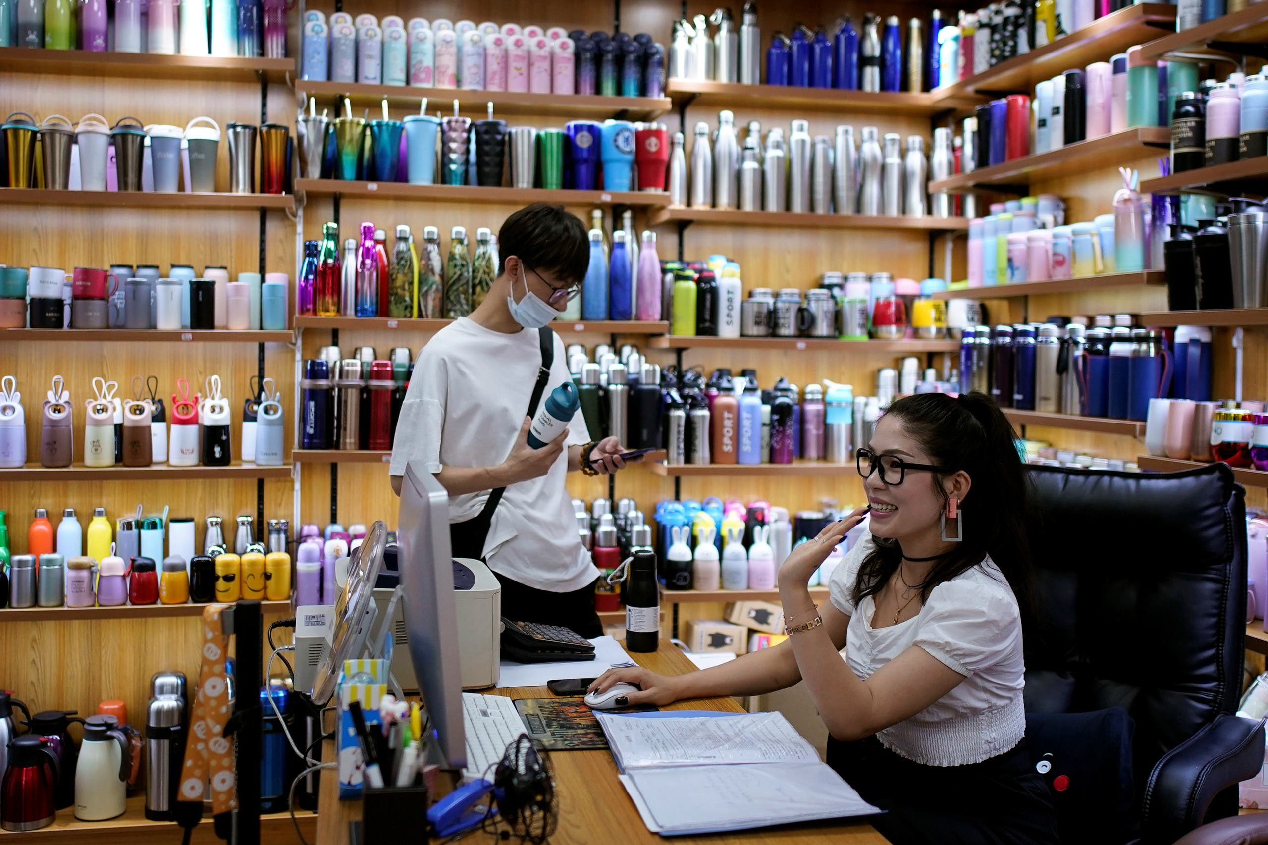 Deng Jinling, manager of Lucky Bird Trade Co. checks her online store in Yiwu, Zhejiang province, China June 2, 2020. (Reuters)