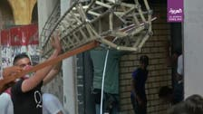 Watch: Lebanese looters ransack furniture shop in central Beirut