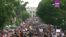 Watch: Thousands march on White House to protest violence by US police