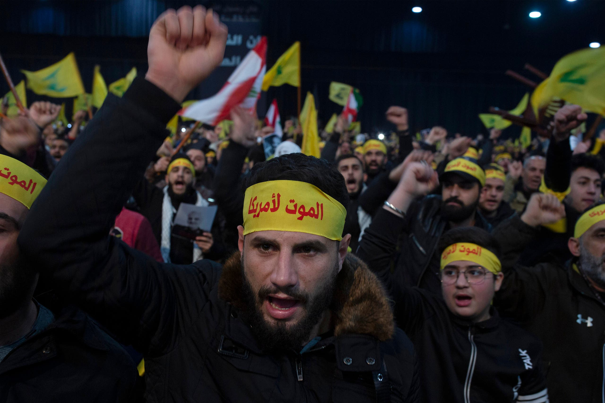 Supporters of Hezbollah chant slogans ahead of the leader's televised speech in a southern suburb of Beirut, Lebanon. The headbands read, Death to America. (AP)