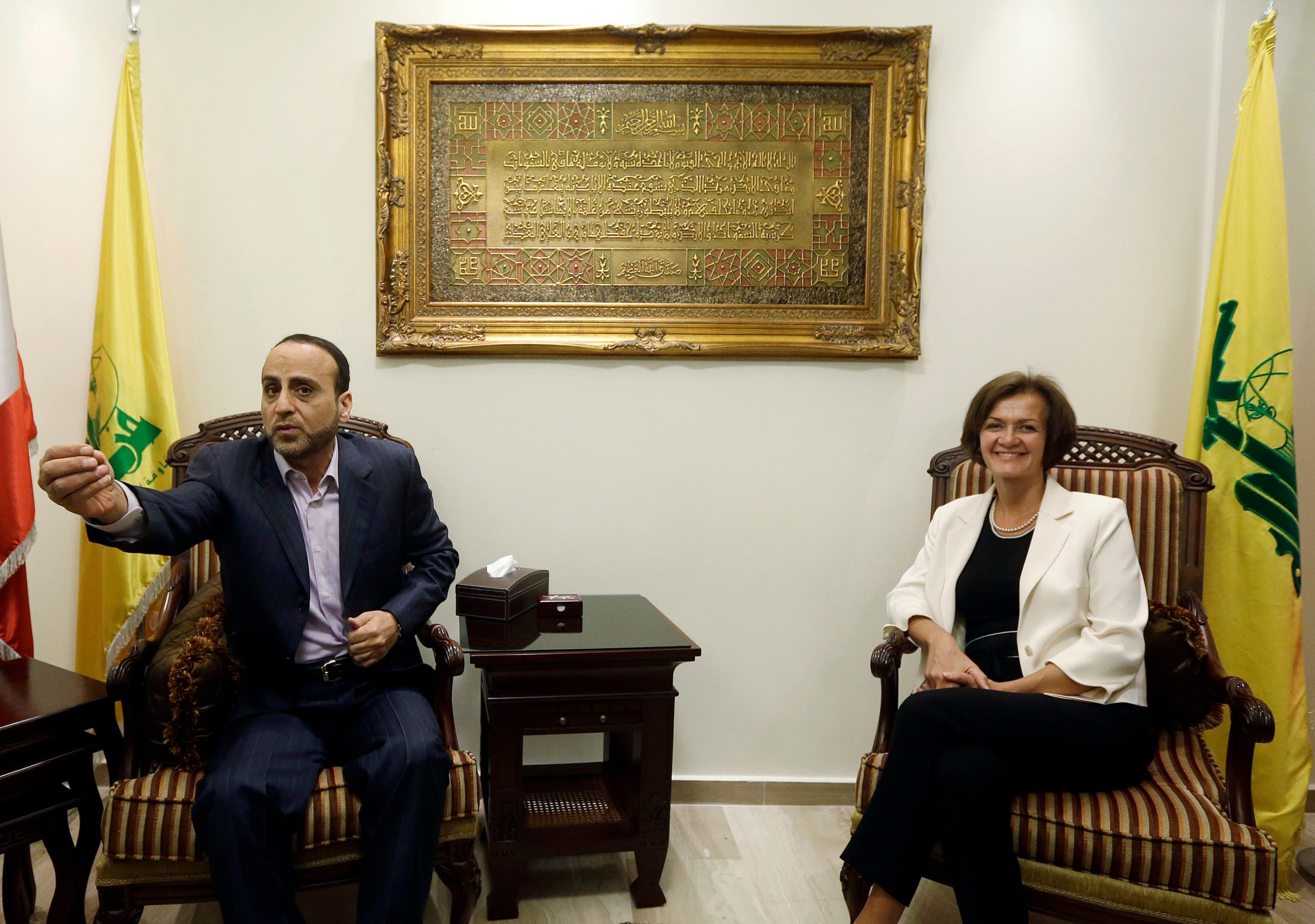 Ammar al-Moussawi, then head of Hezbollah's foreign relations department, left, with EU ambassador to Lebanon Angelina Eichhorst, right, in the southern suburb of Beirut on July 25, 2013. (File photo: AP)