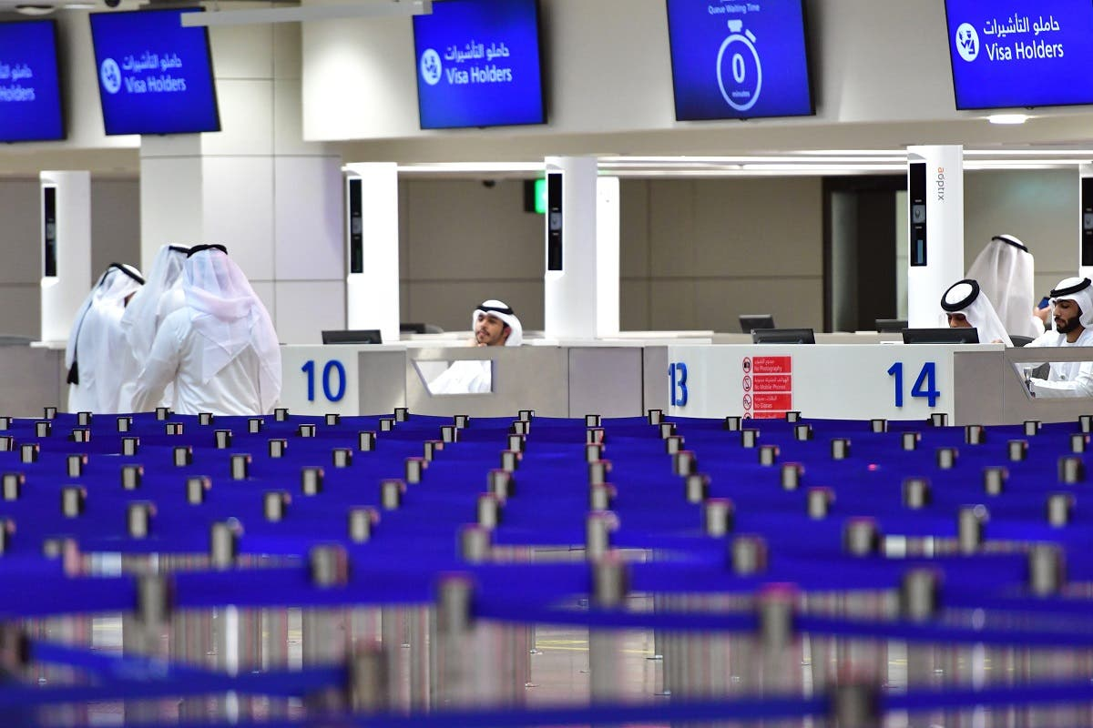 A picture taken on September 14, 2017 shows passport control counters at Dubai's International Airport. (AFP)