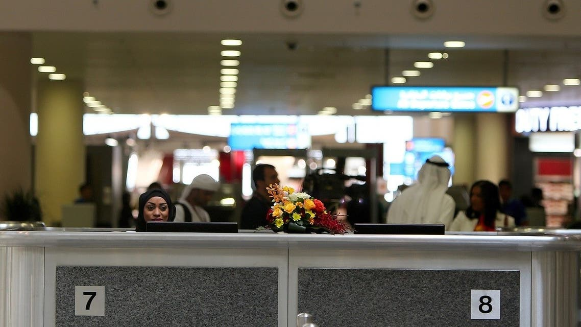 A local employee sits at the passport control at the newly opened Al-Maktoum International airport, the emirate's second airport in Dubai, on October 27, 2013. (AFP)