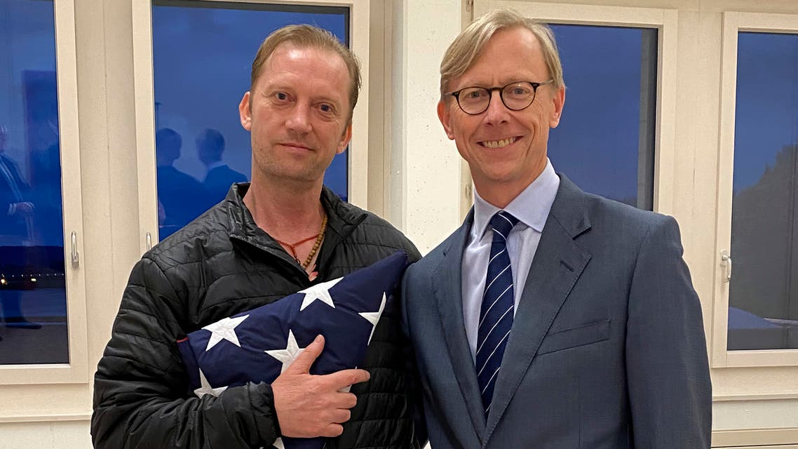 Michael White with US special envoy for Iran Brian Hook in Switzerland, June 4, after White's release. (US State department via AP)