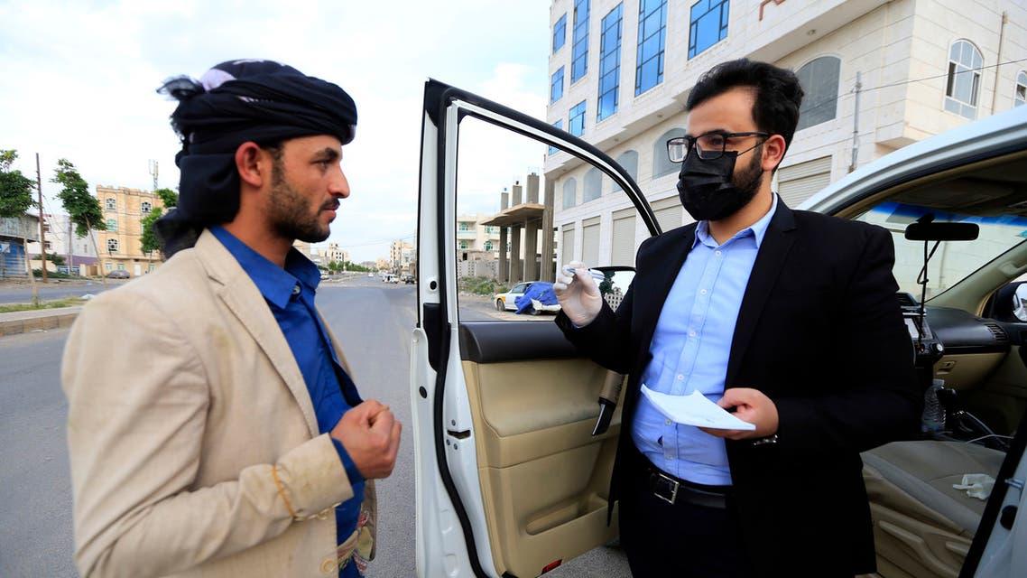 Yemeni physician Sami al-Hajj provides free medical service from his car in Sanaa on June 2, 2020. (AFP)