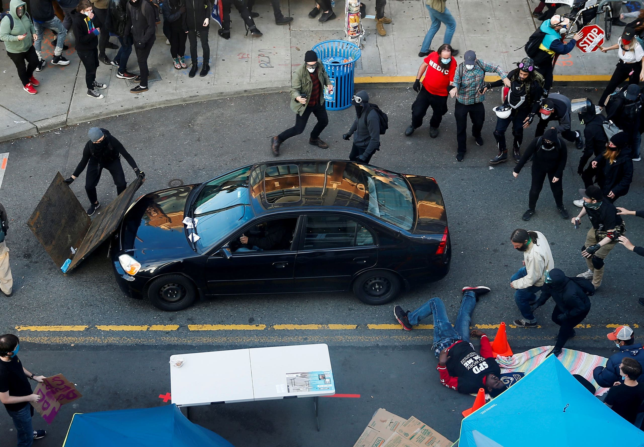 A man drives his car into a crowd of protesters in Seattle, US. (Reuters)