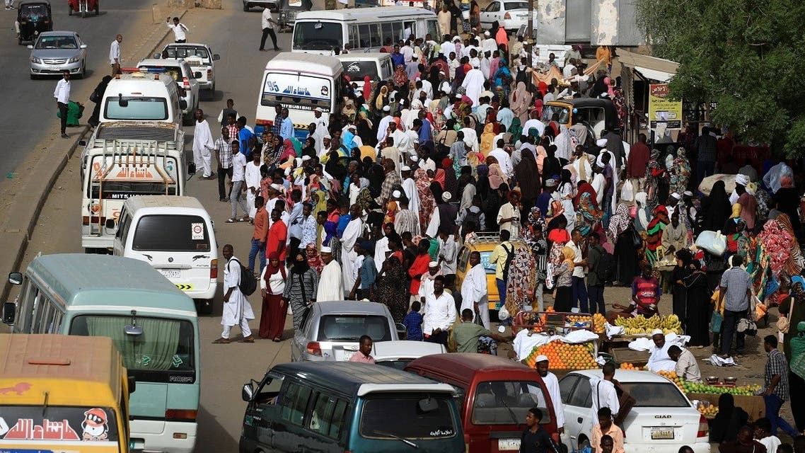 Sudanese residents wait for buses on a street in Khartoum, Sudan, May 4, 2019. (Reuters)