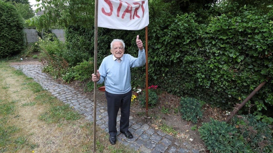 Alfons Leempoels poses next to a start line in his garden in Rotselaar, Belgium June 9, 2020. (Reuters)