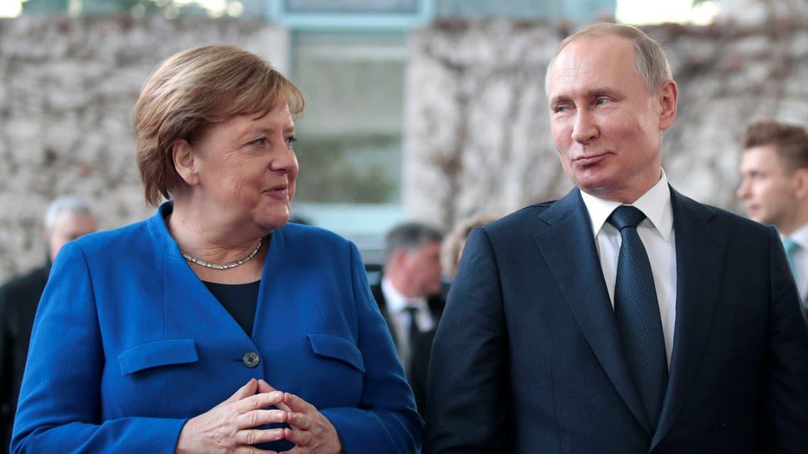 German Chancellor Angela Merkel talks with Russian President Vladimir Putin as he arrives for the Libya summit in Berlin, Germany, January 19, 2020. REUTERS/Michele Tantussi