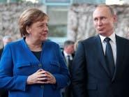 بوتين وميركل يدعوان لوقف القتال في ليبيا وإطلاق مفاوضات