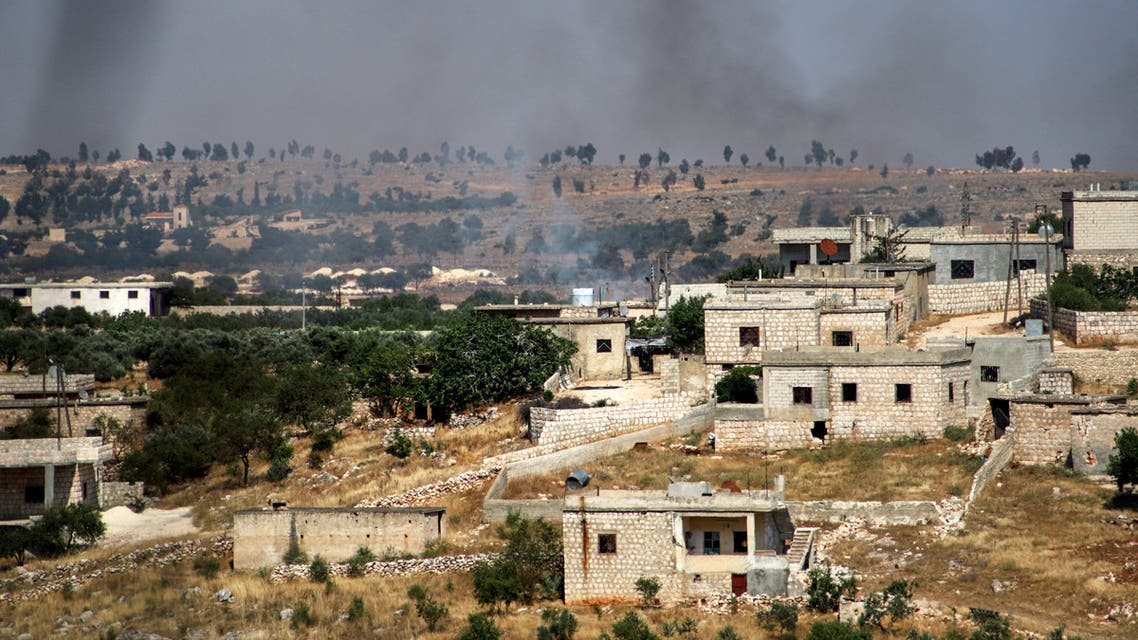 This picture taken on June 4, 2020 shows smoke plumes rising following shelling by pro-Syrian government forces in the town of Banin, north of Maaret al-Numan in Syria's northwestern Idlib province.