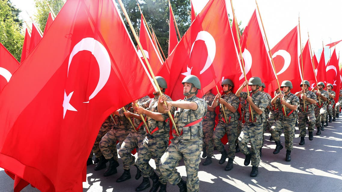 Turkish soldiers march with Turkish national flags as they take part in a parade from the Grand National Assembly of Turkey (TBMM) to the first Turkish Grand National Assembly building in Ulus district of Ankara during celebrations to mark the 97th anniversary of Turkey's Victory Day, on August 30, 2019. Turkey's Victory Day, a national holiday celebrated annually on August 30, is dedicated to Turkey's armed forces and marks the final battle against Greek forces in Dumlupinar in 1922.