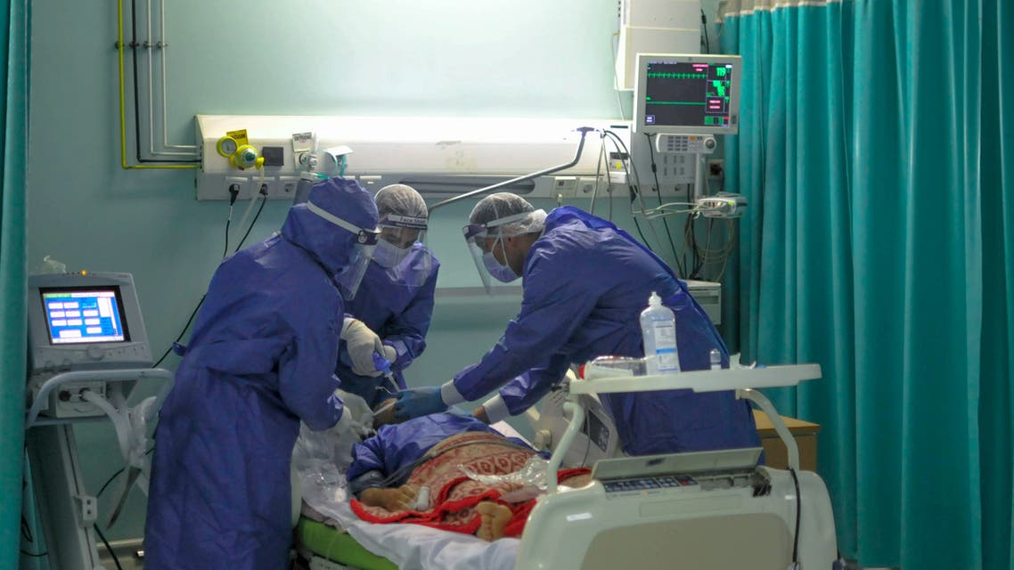 A picture taken by a doctor at the Sheikh Zayed hospital in the Egyptian capital Cairo on April 29, 2020, shows members of a medical staff, wearing protective gear, intubating a patient in the isolated ward for the coronavirus (COVID-19) patients. The virus has so far infected over 8,000 people and claimed 514 lives in Egypt, according to official figures.
