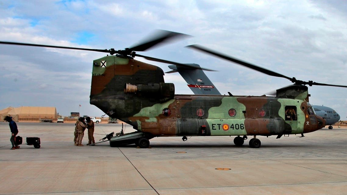 In this Jan. 13, 2020 file photo, a US Air Force plane, background, lands at Ain al-Asad air base, in Anbar, Iraq. (AP)