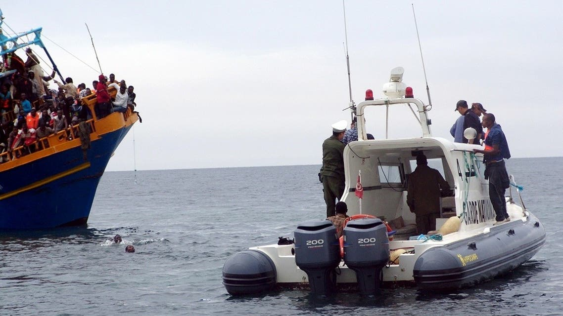 Tunisian coast guards rescue African migrants stranded on a boat coming from Libya, near Sfax, on the Tunisian coast, on June 4, 2011. (File photo: AFP)