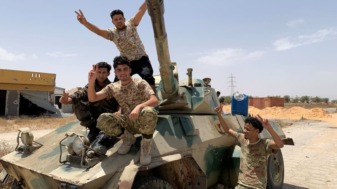 FILE PHOTO: Fighters loyal to Libya's internationally recognised government celebrate after regaining control over the city, in Tripoli, Libya, June 4, 2020. REUTERS/STAFF/File Photo