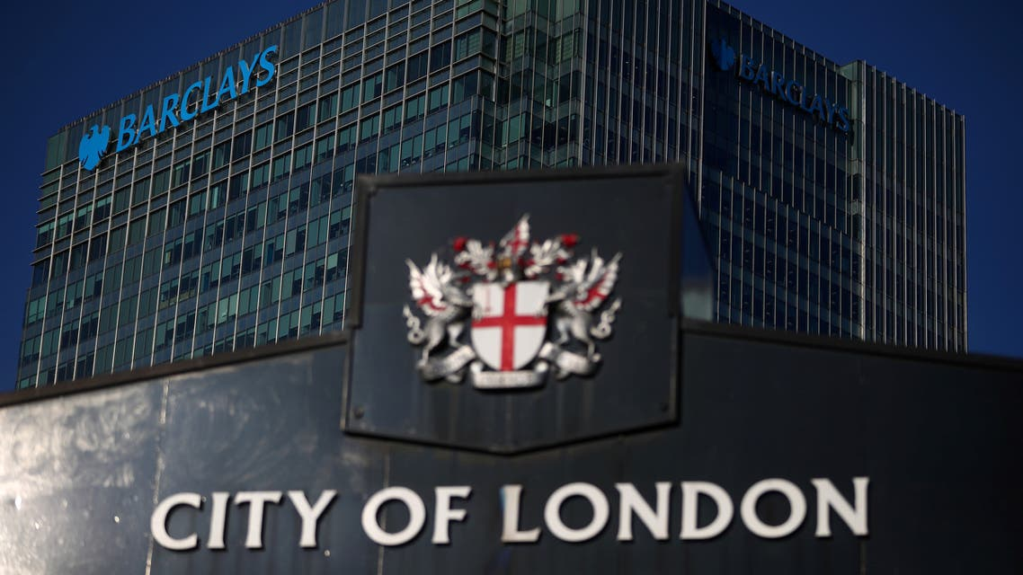 FILE PHOTO: Barclays' building in Canary Wharf is seen behind a City of London sign outside Billingsgate Market in London, Britain, August 8, 2018. REUTERS/Hannah McKay/File Photo