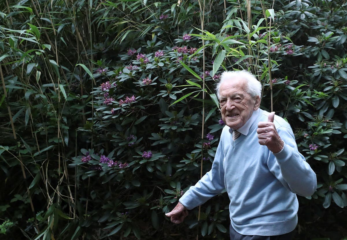 Alfons Leempoels walks in his garden intending to cover a distance equivalent of a marathon to raise money for scientists researching the coronavirus disease in Rotselaar, Belgium June 9, 2020. (Reuters)