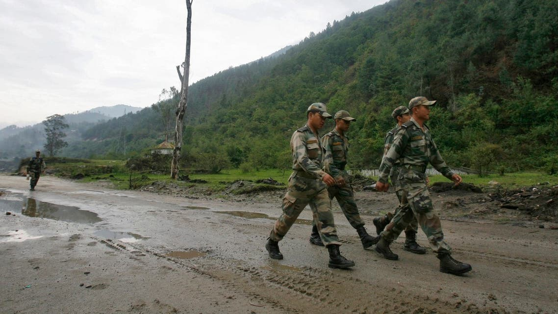 Indian army soldiers march near an army base on India's Tezpur-Tawang highway, which runs to the Chinese border, in the northeastern Indian state of Arunachal Pradesh May 29, 2012. (Reuters)