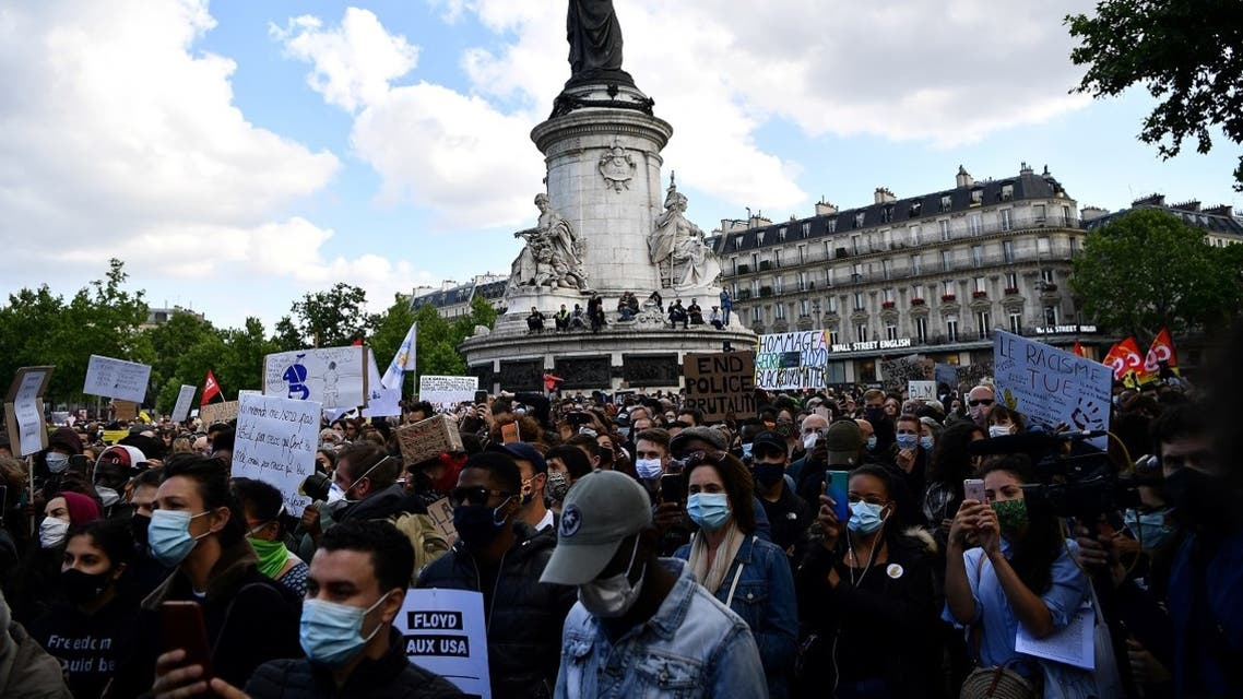 People gather in place de la Republique in Paris, on June 9, 2020, during a demonstration against racism and police brutality in the wake of the death of George Floyd. (AFP)