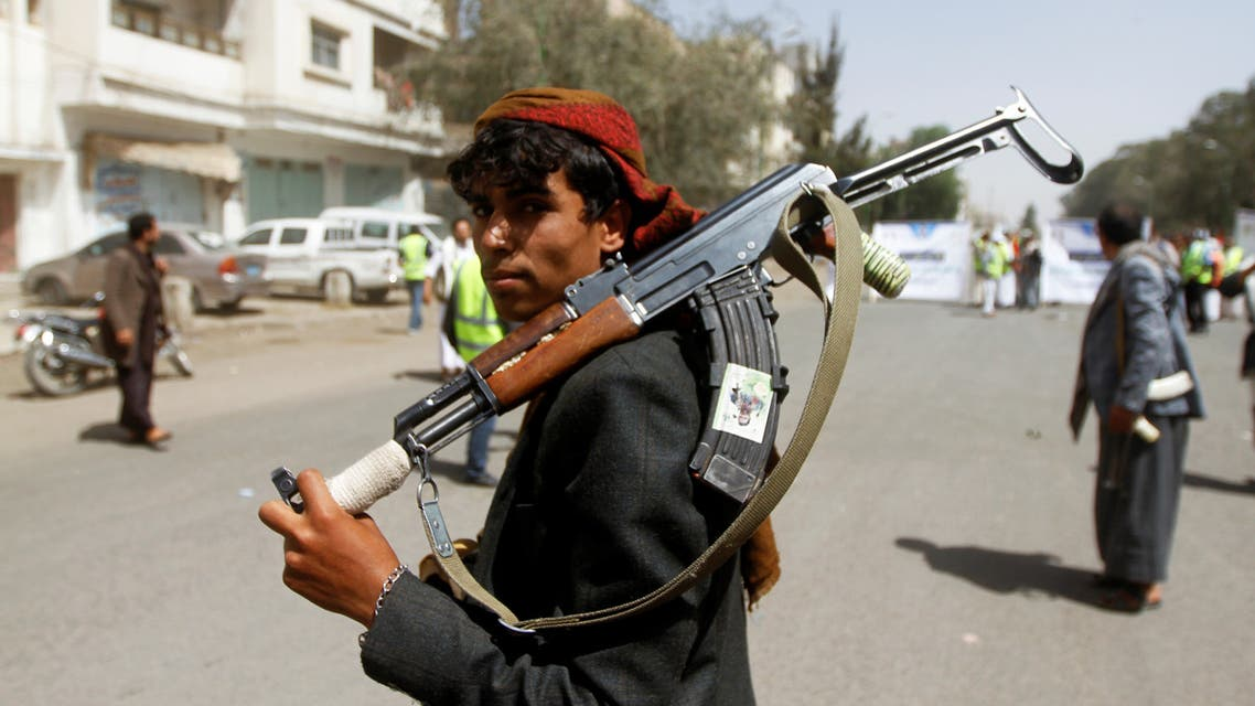 A Houthi supporter looks on as he carries a weapon during a gathering in Sanaa, Yemen April 2, 2020. REUTERS/Mohamed al-Sayaghi