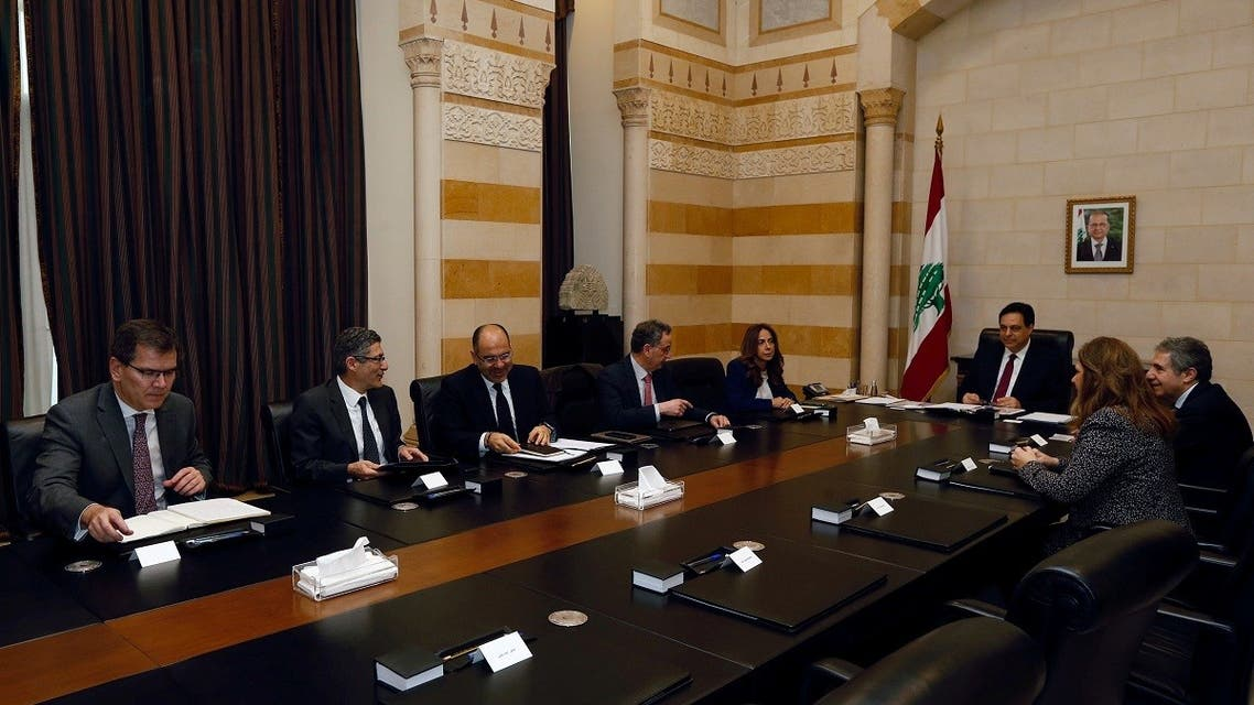 Lebanese Prime Minister Hassan Diab and officials meet with a team of IMF experts at the government palace in Beirut. (Reuters)