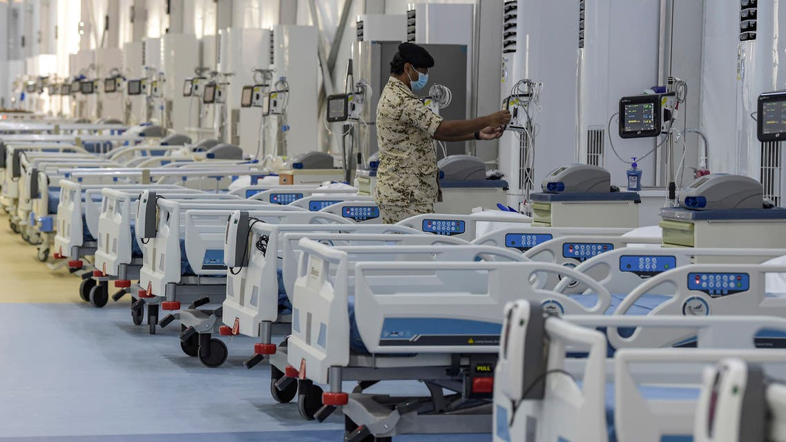 A member of the Bahraini security forces checks patient monitoring equipment at the Sitra field Intensive Care Unit (ICU) hospital for COVID-19 patients in Sitra island south of the capital Manama on May 4, 2020. The hospital, which is attached to a quarantine camp and spread-out over an area of 2400 square meters, is the first field Intensive Care Unit (ICU) to be setup far from a hospital and has its own lab, pharmacy, medical supply store, X-ray machines, and mobile dialysis units. It is run by 55 doctors and 250 nurses. It is the second field hospital out of five planned to add 500 ICU beds to Bahrain's health network.