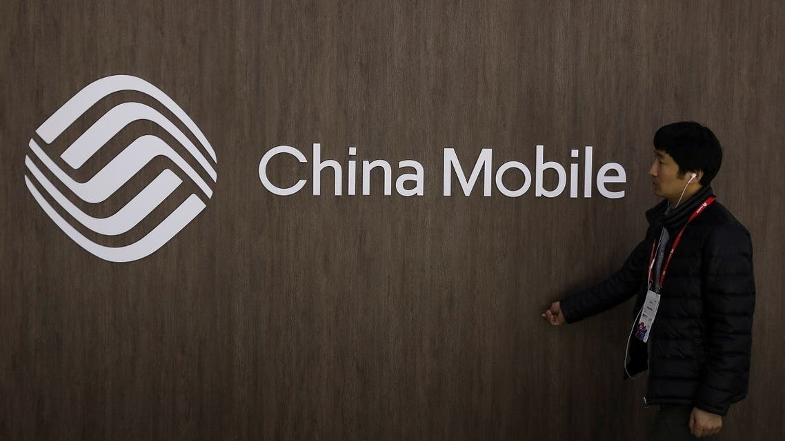 A man walks past the China Mobile logo at the Mobile World Congress in Barcelona. (Reuters)