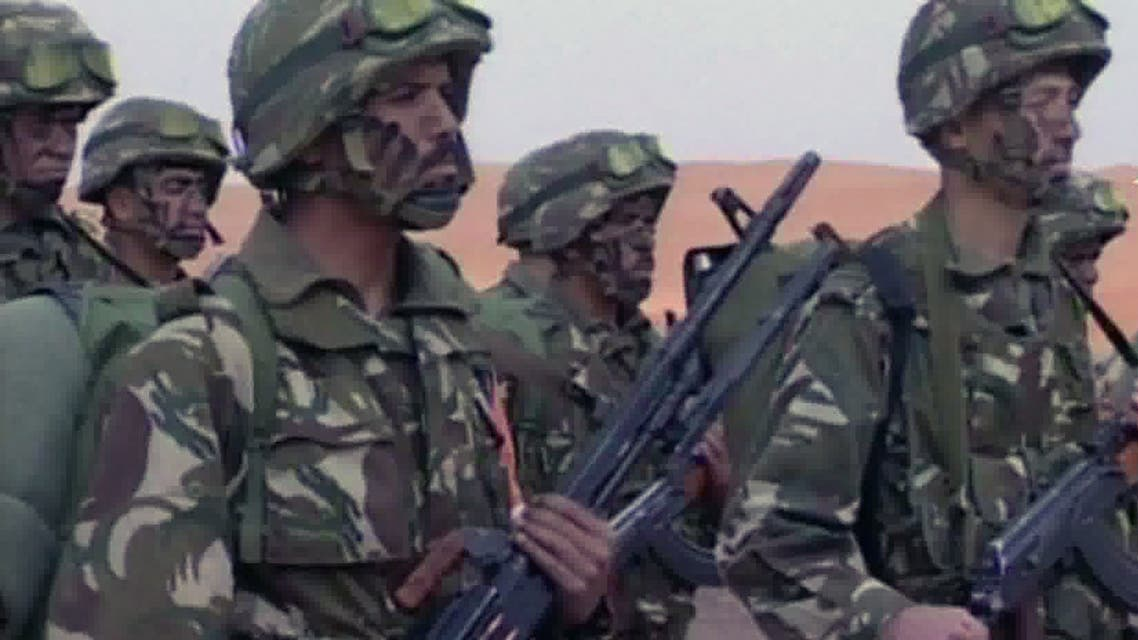 An image grab taken from footage provided by Algeria's Ennahar TV on January 18, 2013 and filmed in June 2012 shows Algerian soldiers preparing for a patrol in the desert at an undisclosed location in the south of the country. Algeria came under mounting international criticism on January 18, 2013 as fears grew for dozens of foreign hostages still unaccounted for after a deadly commando raid against their Islamist captors at a desert gas field. The Islamist militants had seized hundreds of hostages at the field deep in the Sahara, purportedly to avenge a French-led offensive in neighbouring Mali. AFP PHOTO/ENNAHAR TV