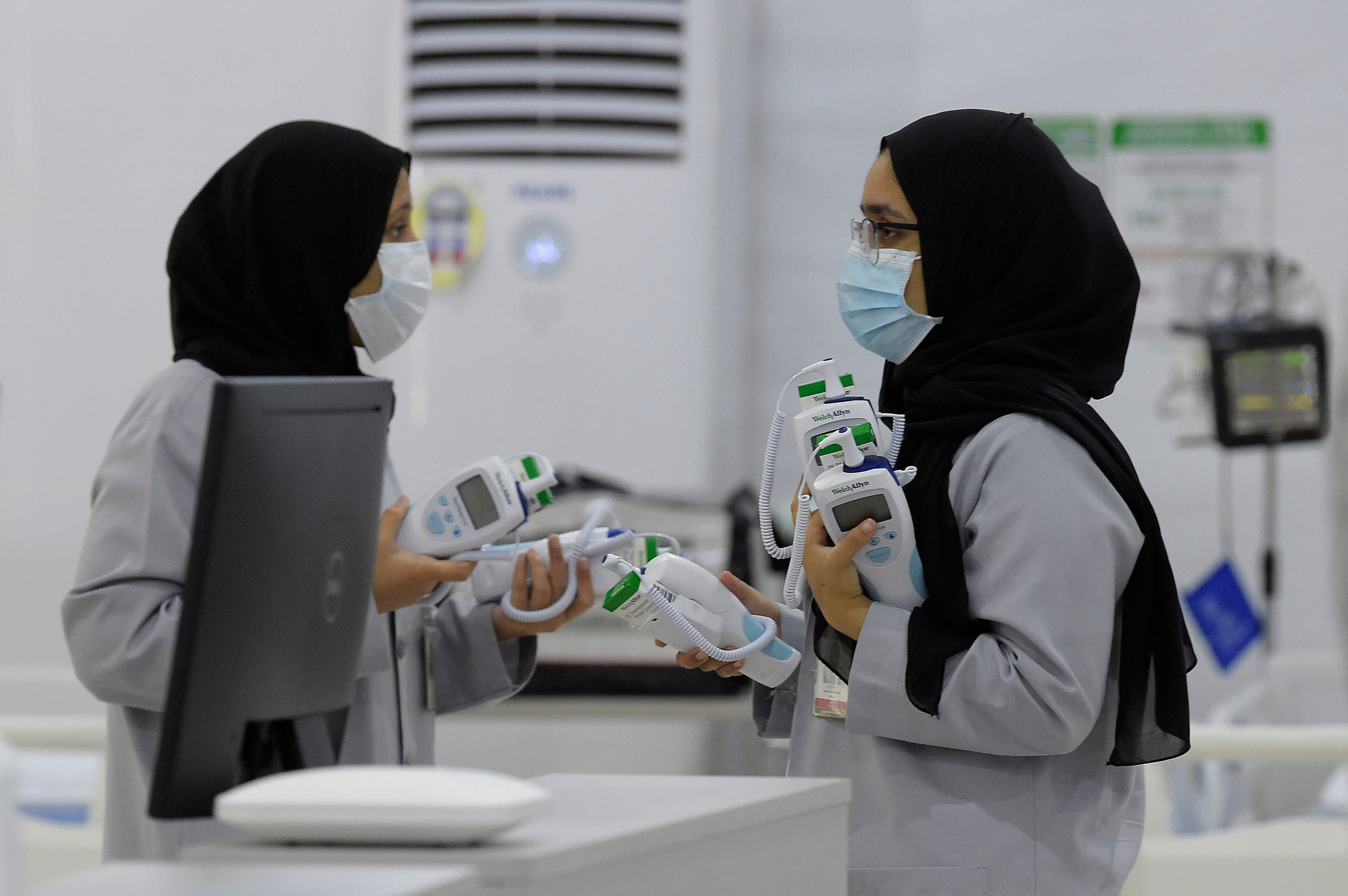 Bahraini health workers are pictured at the Sitra field Intensive Care Unit (ICU) hospital for COVID-19 patients, on May 4, 2020 in Sitra island south of the Bahraini capital Manama. (AFP)