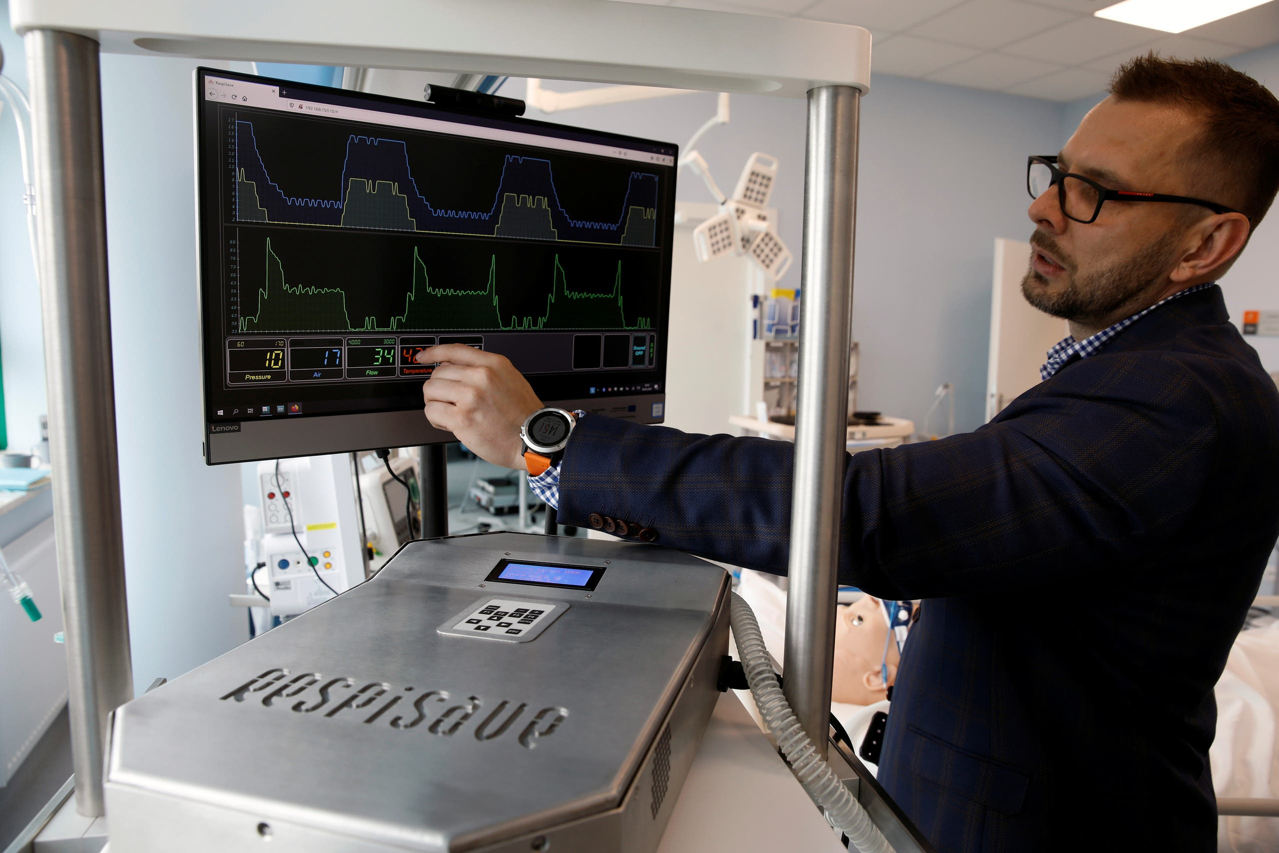 Szarpak presents Respisave, remote controlled respirator at Centre for Medical Simulation MedExcellence in Warsaw. (Reuters)