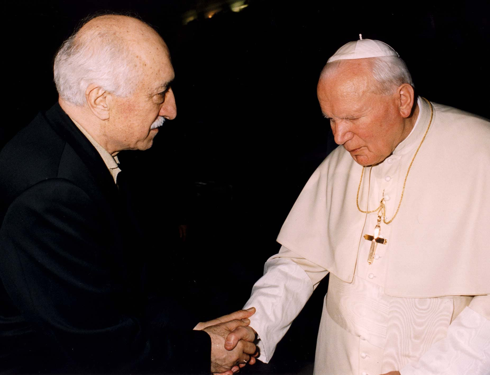 Turkey's Muslim spiritual leader Fethullah Gulen, at left, shakes hands with Pope John Paul II as they meet at the Vatican on February 9, 1998. (AP)