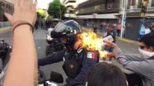 Mexican police officer set on fire during protests in Guadalajara