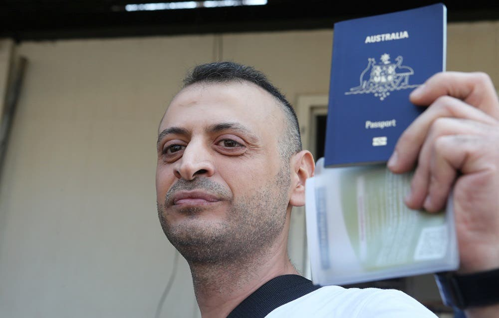 Lebanese-Australian man, Amer Khayat, holds his Australian passport as he is released from Lebanon's Roumieh prison in September 20, 2019. (Reuters)