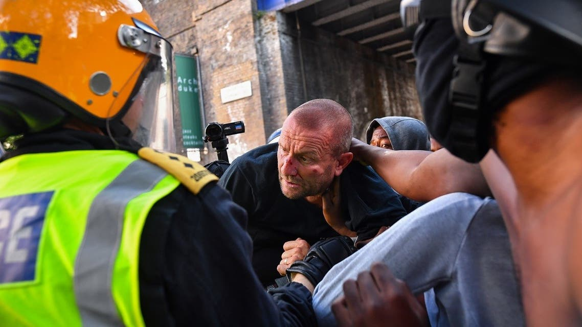 An injured counter-protester is taken by police, during a Black Lives Matter protest following the death of George Floyd in Minneapolis police custody, in London, Britain, June 13, 2020. (Reuters)