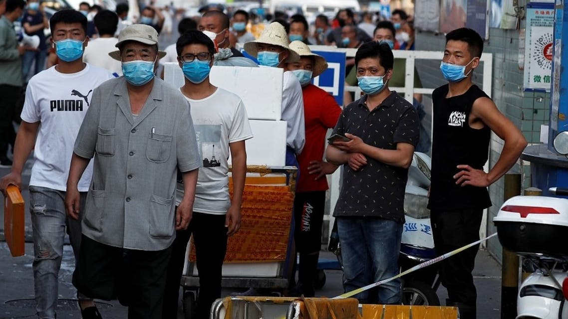 People are wearing face masks inside the Jingshen seafood market which has been closed for business after new coronavirus infections were detected, in Beijing, China, June 12, 2020. (Reuters)
