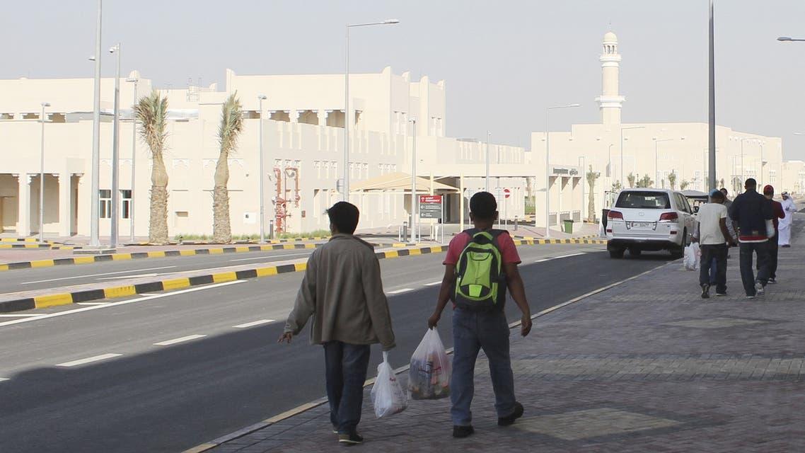 Migrant workers walk at Labor City, Qatar, January 13, 2016. (Reuters)